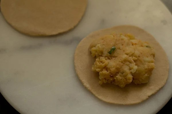 aloo stuffing on rolled paratha