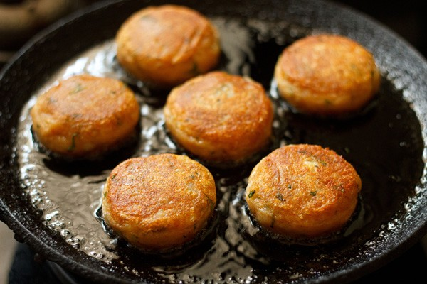 frying aloo tikkis
