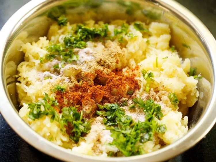 spices, herbs and salt added to mashed potatoes
