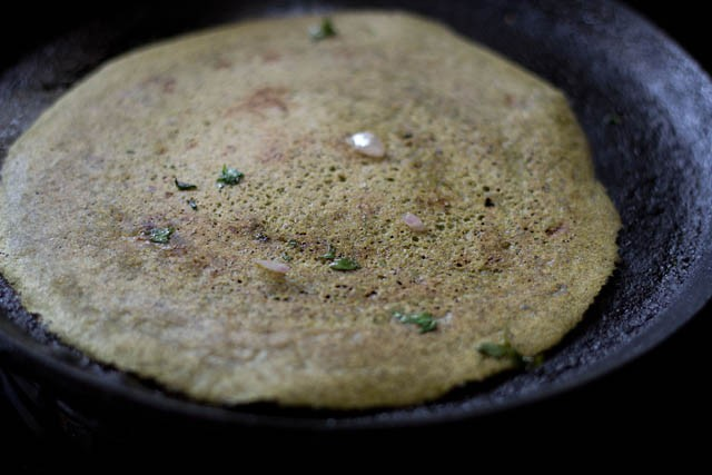 flip and cook moong dal dosa on griddle