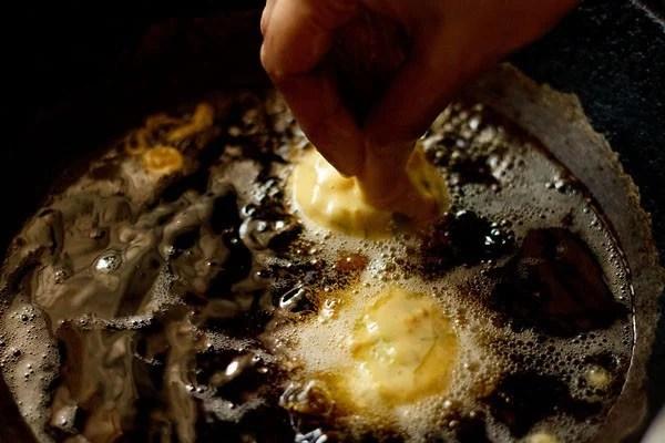 frying vada pav