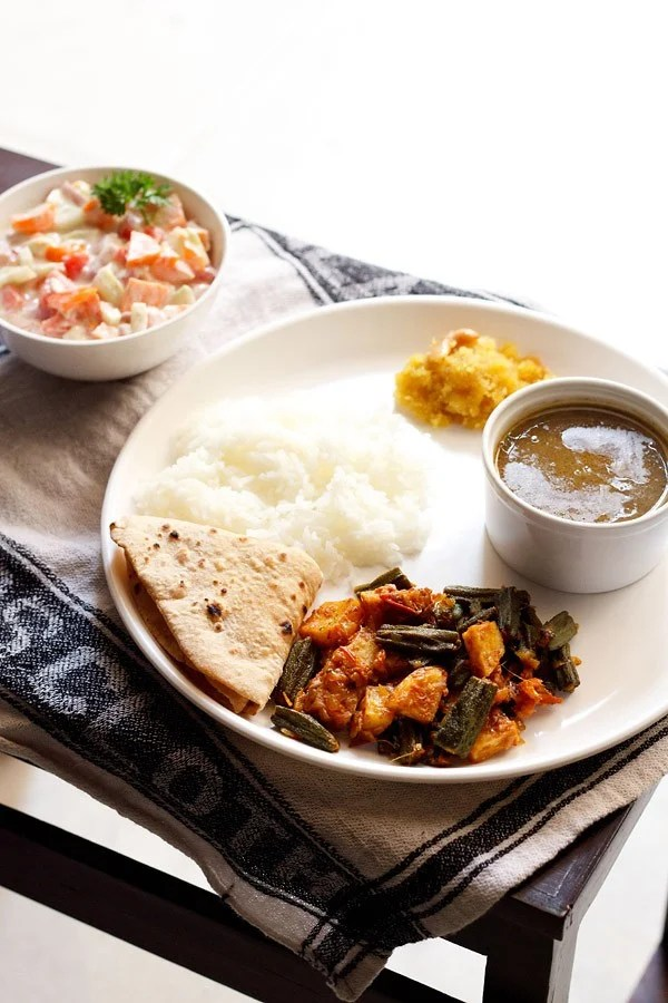 aloo bhindi served in a plate with roti