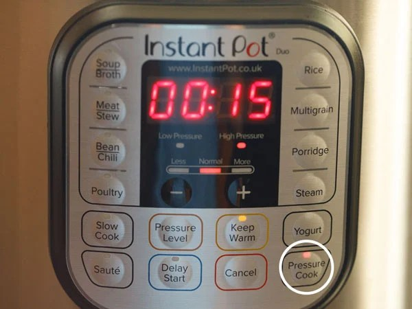 setting pressure cook mode and timer to 15 minutes