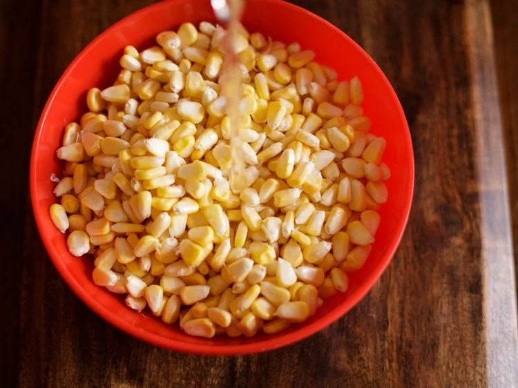 rinse corn kernels in water and drain all water