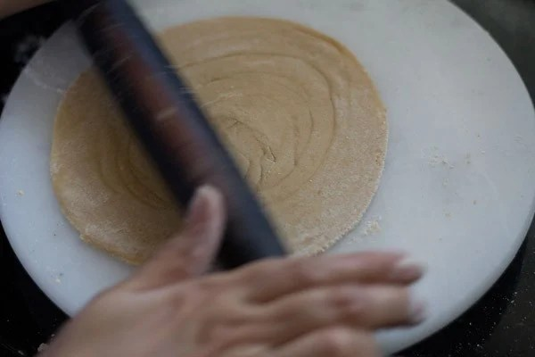 roll the paratha into 7 inches