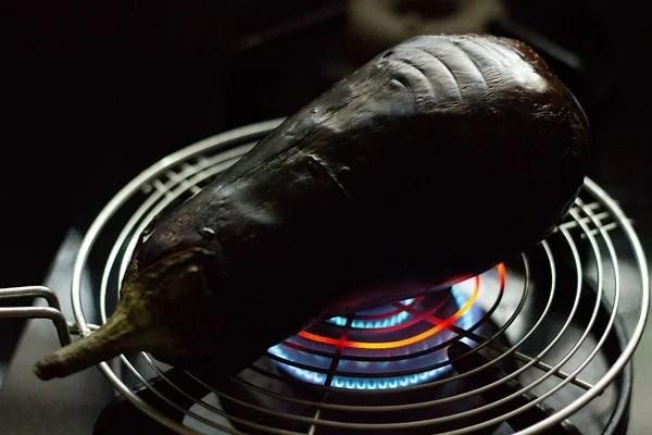 roasting baingan for Baingan Bharta Recipe