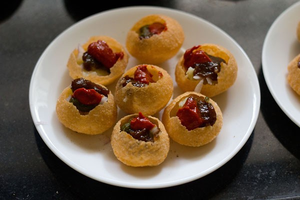 add chutneys to puris