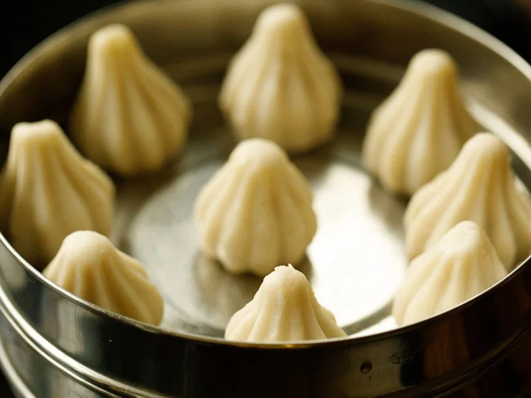 modak placed in a greased pan