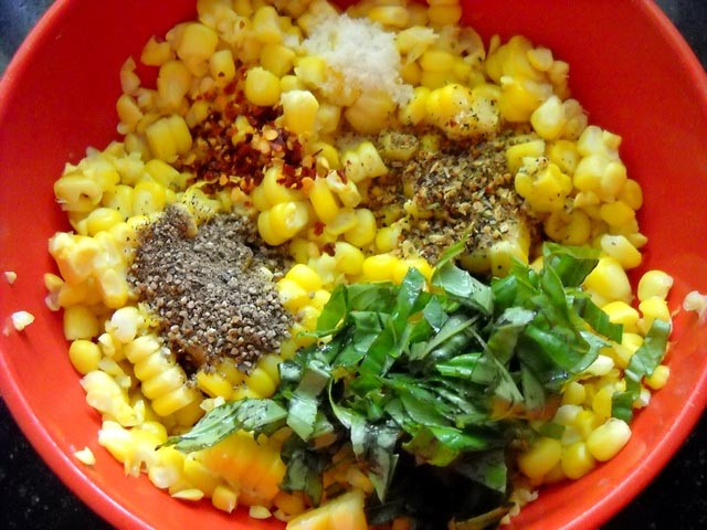 corn kernels with spice ingredients and basil