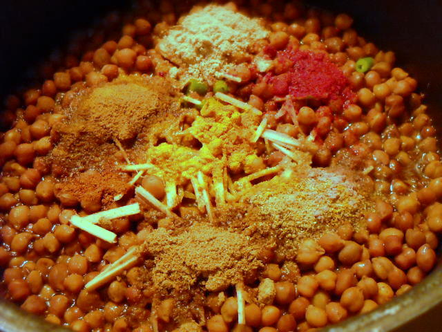 adding dry powders for sookha kala chana recipe