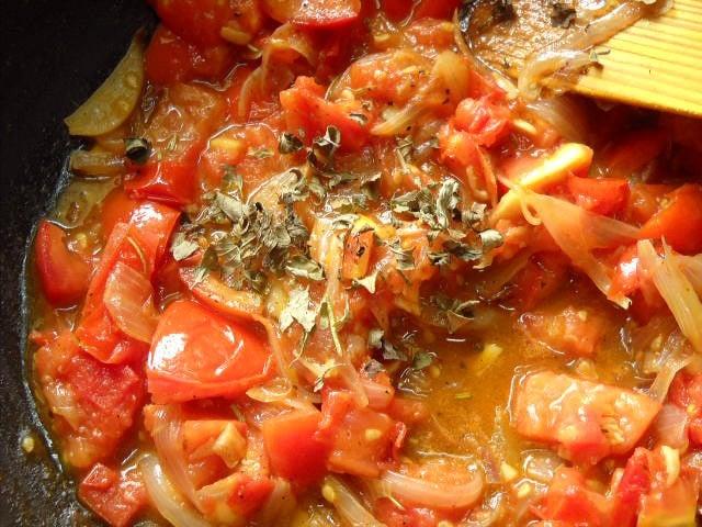adding oregano for tomato mushroom penne pasta recipe