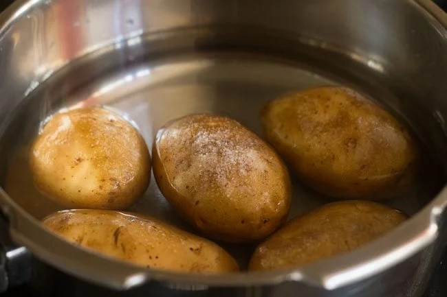 potatoes in a pressure cooker with salt added