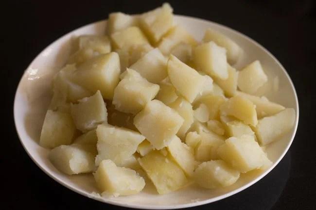 peeled and chopped potato cubes for making jeera aloo
