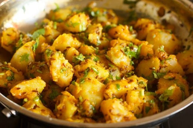 coriander leaves mixed with the jeera aloo
