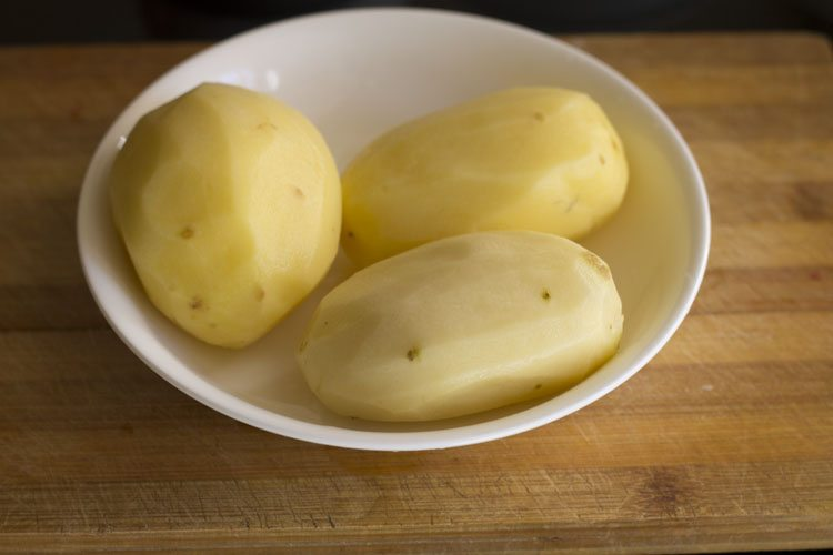 peel and then rinse 3 large potatoes in water