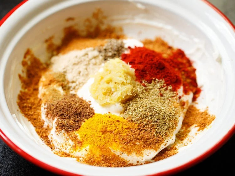spice powders and ginger-garlic paste added to hung curd