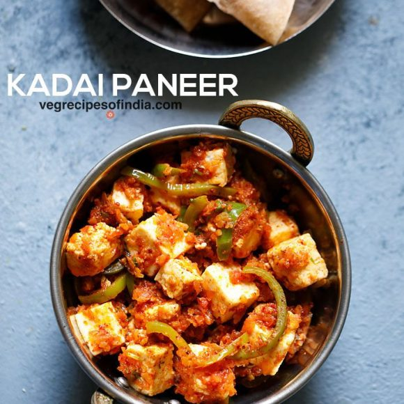 "kadai paneer in a small kadai (Indian wok) on a light blue board with a bold text of ""kadai paneer"" listed on image"
