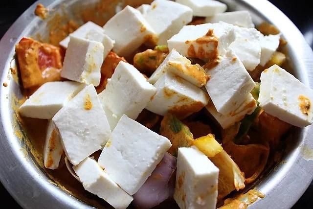 mixing paneer veggies in marinade for paneer tikka recipe