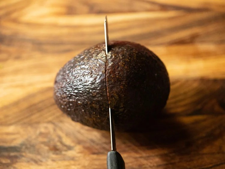 cutting ripe avocado