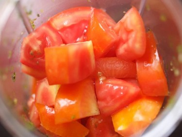 chopped tomatoes in a blender