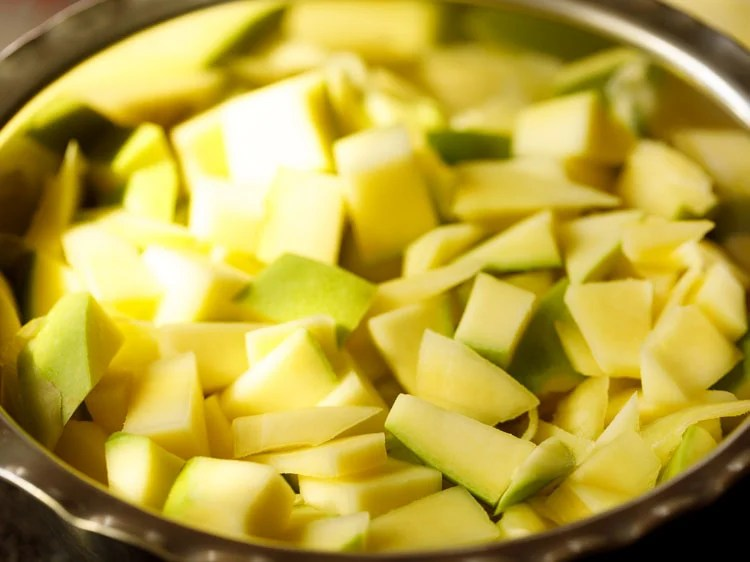 chopped mangoes in a large mixing bowl