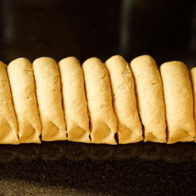 pita bread dough log sliced in equal portions