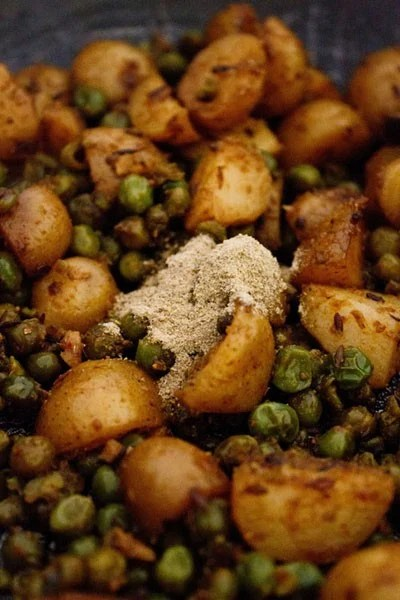 add masala to dry aloo matar