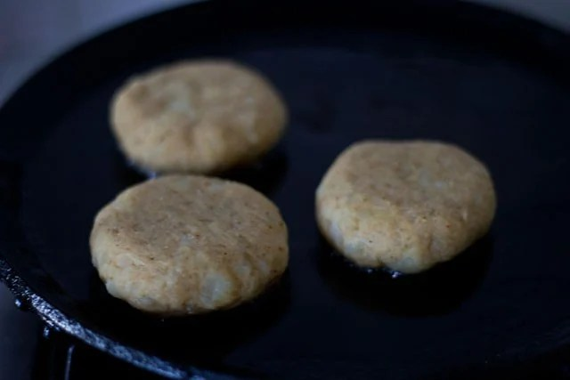 frying tikkis for making aloo tikki chole recipe