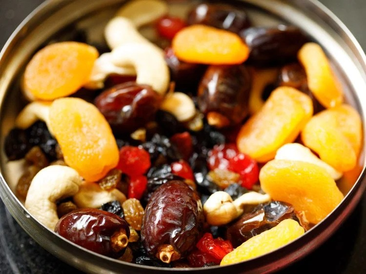 nuts and dried fruits in a steel bowl