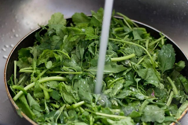 washing greens for sarson ka saag