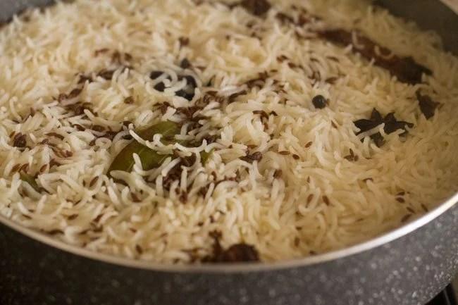 preparing easy jeera rice recipe