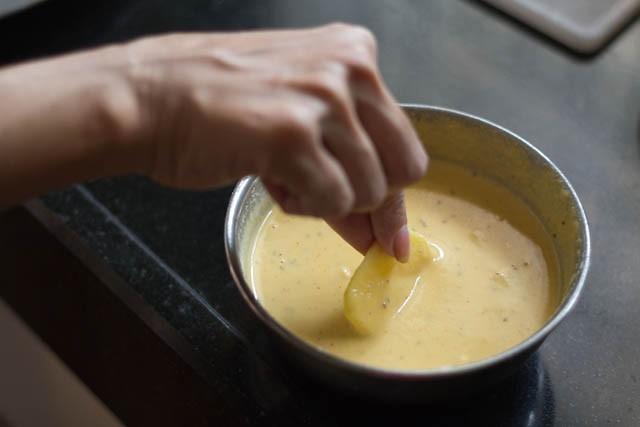 dip the potato slice in the batter
