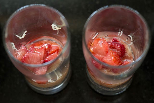add 1 or 2 tbsp the macerated strawberries along with the syrup