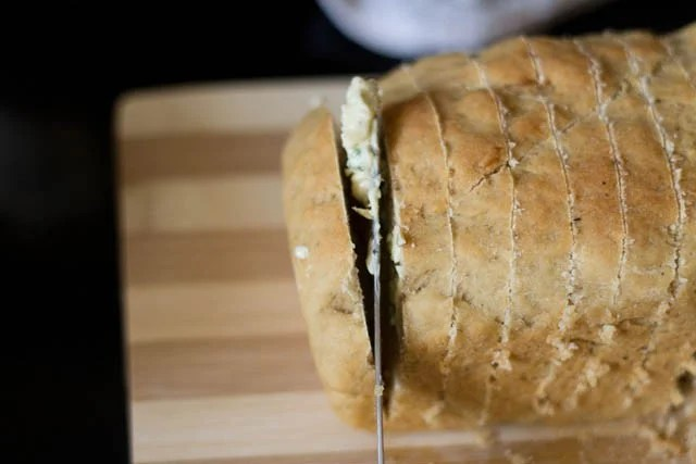 spread the garlic spread on the slices of the bread