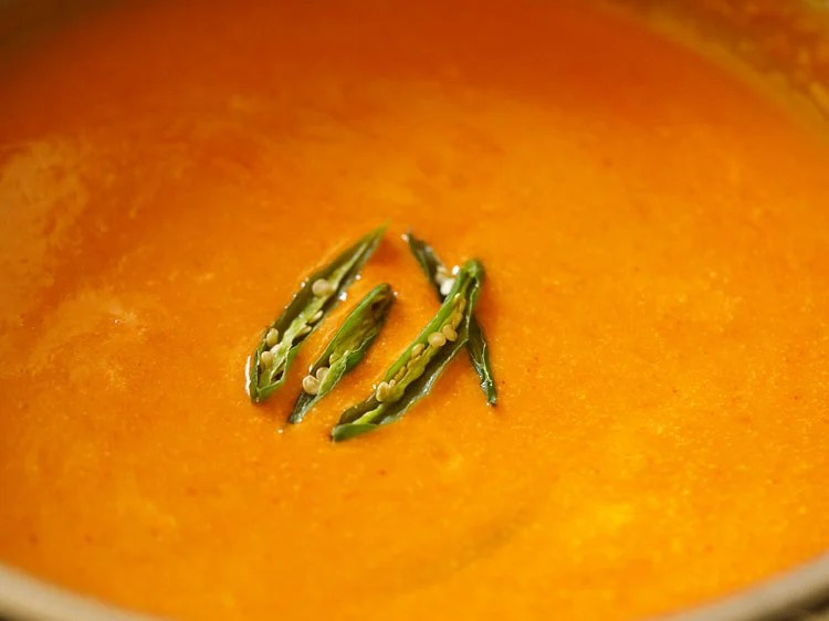 slit green chillies added to gravy