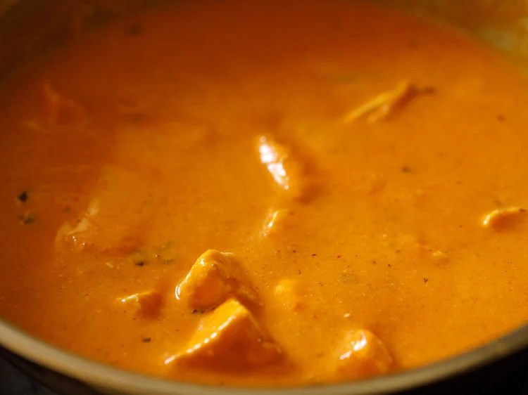 cream mixed evenly and paneer butter masala ready to be served