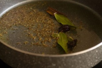cinnamon stick, caraway seeds, bay leaf, cloves and cardamom pods added to ghee for tadka