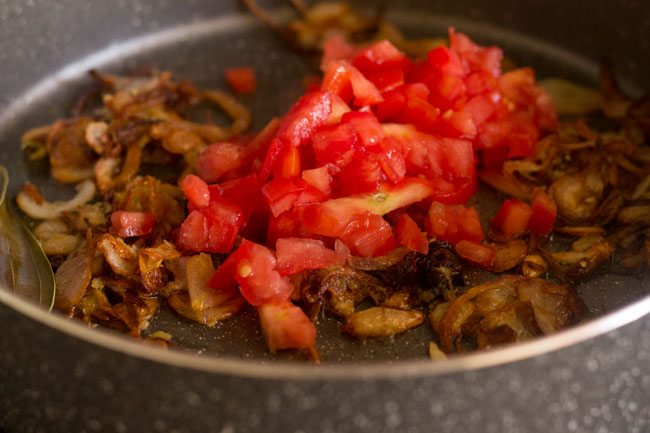 adding tomato for palak biryani