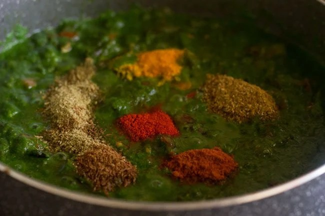 adding spices for palak biryani