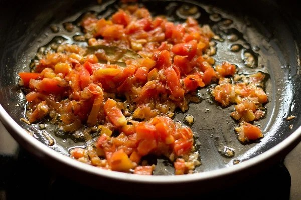 sautéing tomatoes to make palak paneer recipe