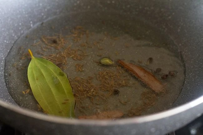frying spices in the hot oil.