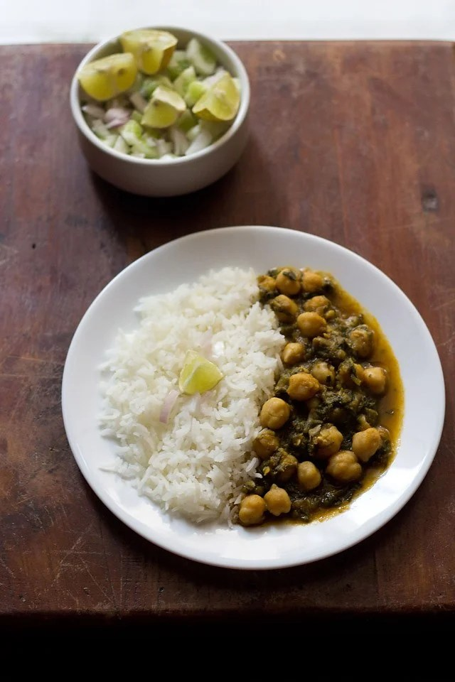 palak chole served in a plate with rice