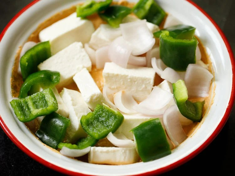 paneer cubes, onions and green bell pepper added