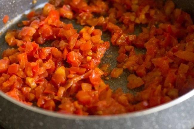 preparing aloo tamatar sabzi recipe