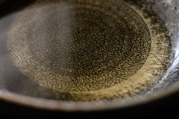 preparing kaju katli - sugar water solution