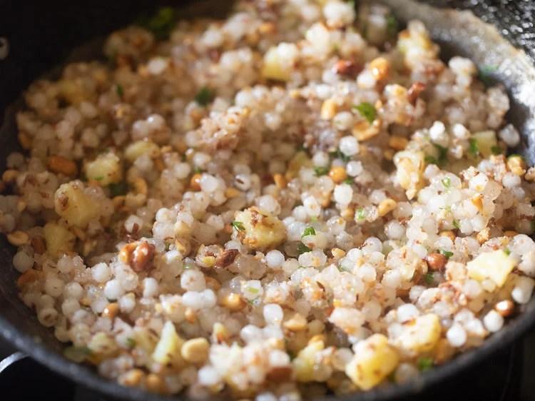 mix coriander leaves with  cooked sabudana khichdi