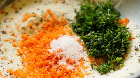 carrots and coriander leaves added to rava mixture