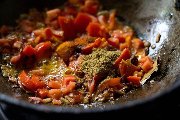 add spices - making cabbage koftas