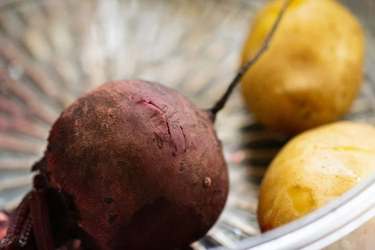 steamed beetroot and potatoes in a steamer pan