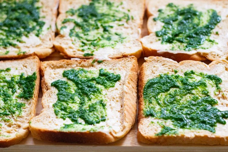 butter and green chutney spread on bread slices